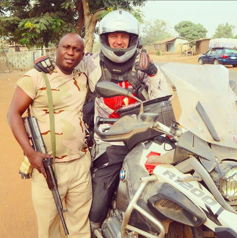 Me with a cop in Nigeria.