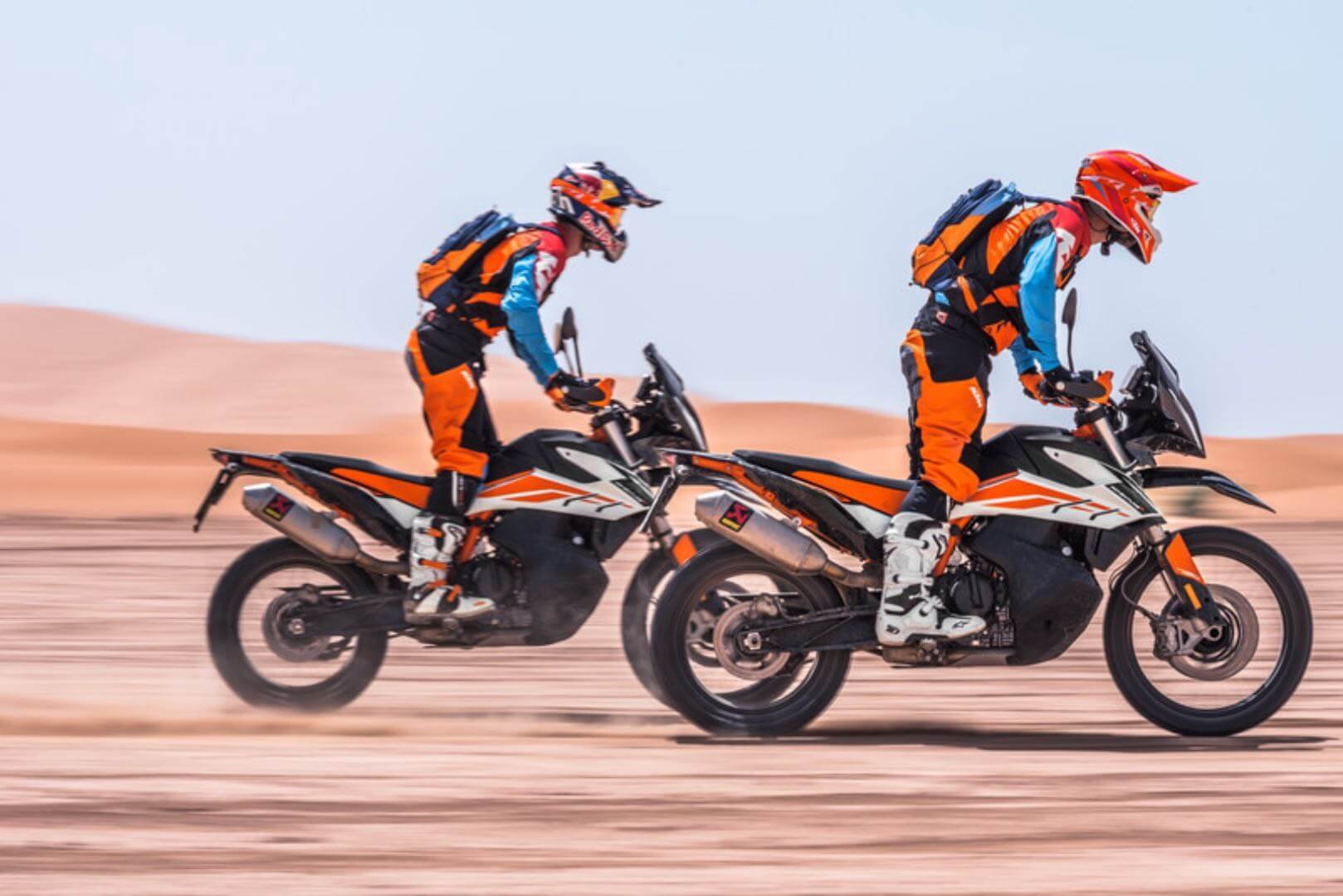 Two men riding the KTM 790 R